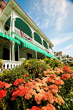 Front porches of the Victorian seaside Chalfonte Hotel, where guest can sit in rocking chairs, and appreciate bygone days..