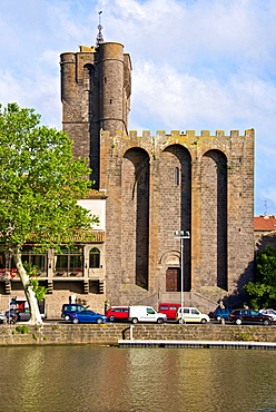 Fortified Ancienne cathedrale St Etienne, 12thc., built in black lava,and river banks along Herault river, AGDE town, Haut Languedoc,34 France.