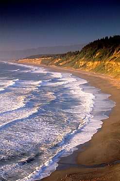 Waves at sunset rolling on to Agate Beach, Patricks point State Park, Humboldt County coast, Northern California Waves at sunset along Agate Beach, Patricks Point State Park, Trinidad, Humboldt County, CALIFORNIA.