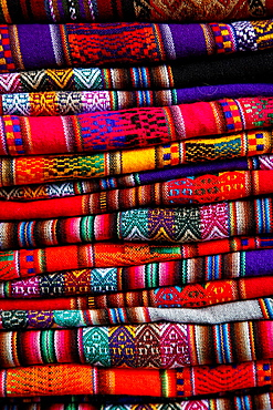 Local carpets made of llama and alpaca wool for sale at the market, Cuzco, Peru.