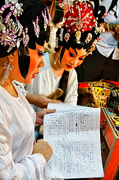Chinese opera performers prepare for a performance at the Vegetarian Festival in Bangkok, Thailand.