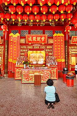 praying in Kong Hock Keong Shrine in Georgetown in Penang, Malaysia.