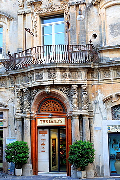 Portal of baroque house, street in old town, Noto, Sicily, Italy.