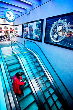 Lausanne metro access with swiss watch advertising. Lausanne, Vaud, Switzerland, Europe.