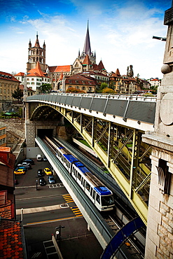 The Bessières pont, bridge with two heights of Lausanne, for trams and cars and Lausanne Cathedral in the background. Lausanne, Vaud, Switzerland, Europe.