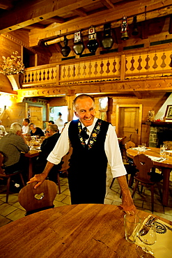 Lucien, the restaurant owner and Maitre Solalex, in the natural famous for his walls very conducive for climbing called the Miroir d'Argentine. Villars, Vaud, Switzerland, Europe.