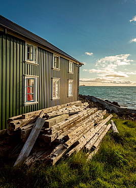 Wood planks by side of summer house on Flatey Island, Borgarfjordur, Iceland.