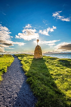 Path and sign on Flatey Island, Borgarfjordur, Iceland.