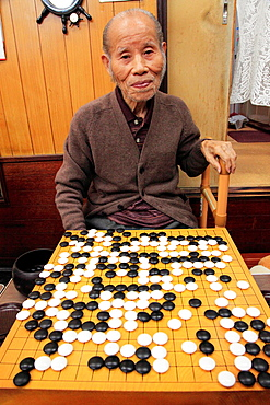 Japan, Kyoto, go player, strategic board game,.