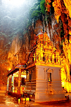 Temple in Batu Caves are a set of caves, some of which have been converted into temples, in a limestone hill located 10 kilometers north of Kuala Lumpur, Malaysia.