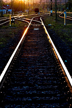 Evening sun reflecting in railroad tracks with traffic lights in Gallivare swedish lapland sweden.