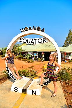 two european girls at the equator-line in Uganda