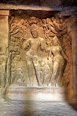 Cave 1 : Elephanta Caves. The Great Cave. Panel of Shiva-Parvati with Gods and attendants. Circa 550 A.D. Maharashtra, India.