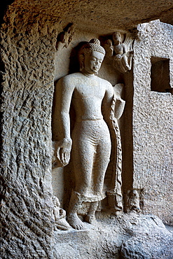 Cave 3 : Standing Buddha image in Varada mudra outside on the left of Chaitya, Kanheri Caves, Borivali, Mumbai, India