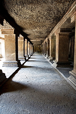 View of row of pillars in verandah and an unfinished panel on the south. Pataleshwar rock-cut temple, Jangli Maharaj road Pune.