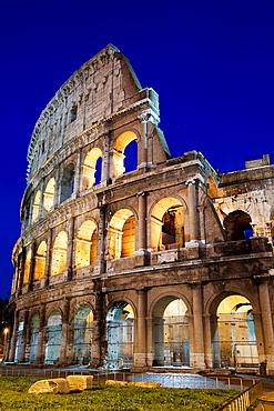 The Roman Colosseum and car light-trails, Rome, Lazio, Italy, Europe.