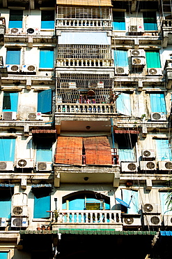 Old building terraces with airconditioners in Yangon in Myanmar.