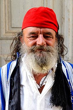 Greek man dressed like an evzone guard in Rethymno - Crete, Greece.