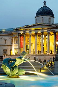 Fountain and National Gallery at Trafalgar Square, London, England, UK
