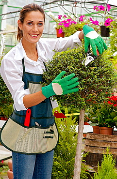Woman pruning at garden centre