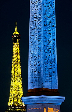 The obelisk of Place de la Concorde (Blue Klein) and Eiffel Tower, Paris, France.