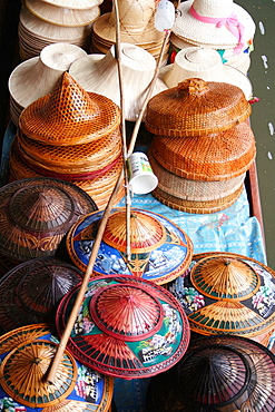 Straw hat collection on vendor's boat, Floating Market, Damnoen Saduak, Bangkok, Thailand, Asia