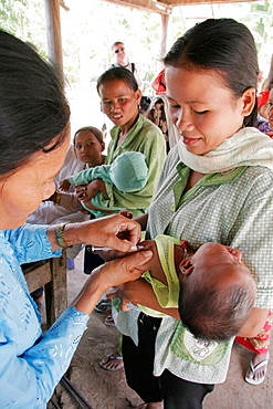 Baby receiving an immunisation shot, at a rural health centre in Kampong Thom, Cambodia