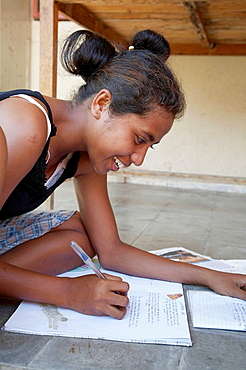 Girl studying, Topu Honis orphanage and children's home, Oecussi-Ambeno, East Timor