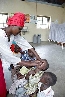 Immunising children at Kowak hospital, Tanzania