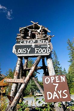 'Cheap Beer & Lousy Food' offered on Exit Glacier Road, Seward, Kenai Peninsula, Alaska, USA.