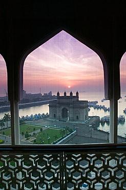 Gateway of India at dawn from Taj Mahal Hotel balcony, seen through mosquito net, Bombay, Maharashtra, India (2004) - 817-79817