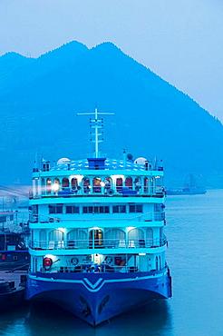 China, Chongqing Province, Yangzi River, City of Fengdu, View of Yangzi River Cruise ships by Fengdu Ghost City / Dawn