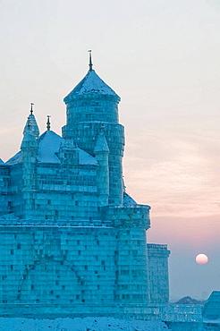 China, Heilongjiang, HAERBIN (Harbin): Haerbin Ice and Snow World Festival, All Buildings built of ice, Ice Church at Sunset