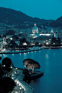 Italy, Lombardy, Lakes Region, Lake Como, Como, city view from Bellagio road, evening