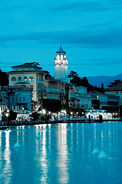 Italy, Lombardy, Lake District, Lake Garda, Gardone Riviera, lakefront town view with Grand Hotel, dusk