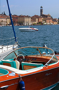Italy, Lombardy, Lake District, Lake Garda, Salo, town view with Riva speedboat