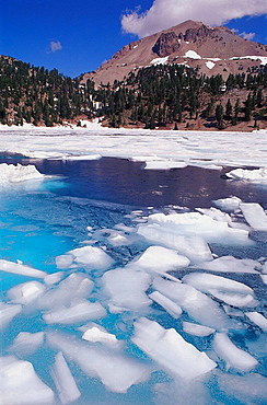 Lake Helen thawing in summer below Lassen Peak, Lassen Volcanic National Park, California, USA
