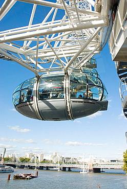 UK, London, Pod of the London Eye ferris wheel high over London