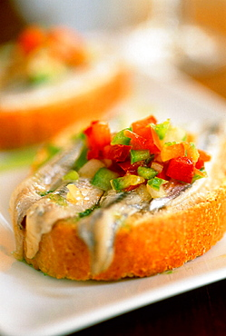 Spain, Andalusia, Jerez, Local cooking tapas, 'Boquerones' marinated anchovies and peperoni at the restaurant 'Gallo Azul'