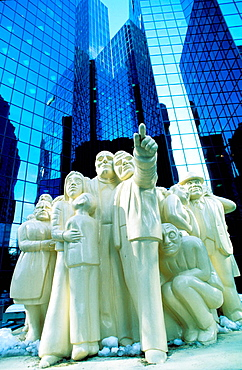 'The Iluminated Crowd', sculpture by Raymond Mason at the esplanade of the twin towers complex of BNP Tower and Laurentian Bank Tower, Montreal, Canada