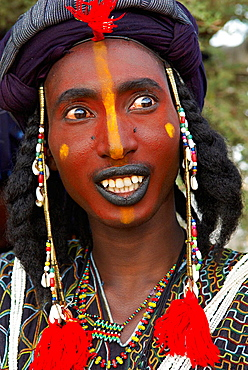 Niger, A Wodaabe-Bororo man with his face painted for the annual Gerewol male beauty contest...