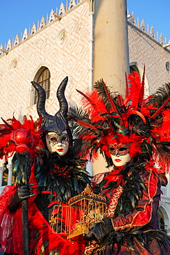 Masks at the Venice Carnival in St. Mark's Square, Venice, Veneto, Italy, Europe