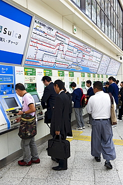 Passengers purchasing train tickets from vending machines at the JR Ueno railway station in Tokyo, Japan, Asia