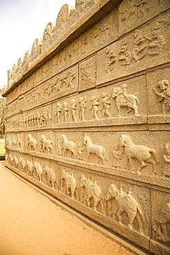 Bas relief scenes from life in the Vijayanagar Empire on the Mahanavami Dibba within the royal enclosure at Hampi, UNESCO World Heritage Site, Karnataka, India, Asia