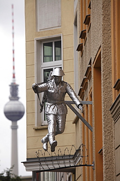 Berlin Television Tower (Fernsehturm) and sculpture of a soldier jumping the Berlin Wall at Bernauerstrasse, Berlin Germany, Europe