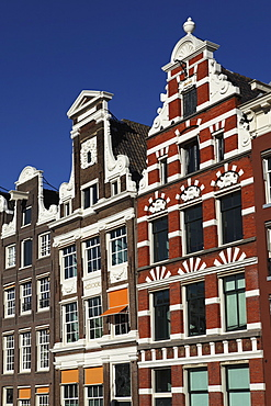 Traditional facades of Dutch townhouses in Amsterdam, The Netherlands, Europe