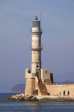 The Venetian era harbour walls and lighthouse at the Mediterranean port of Chania (Canea), Crete, Greek Islands, Greece, Europe