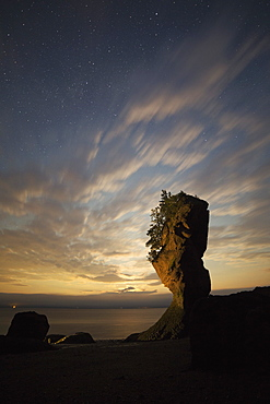 Hopewell Rocks, the flowerpot rocks, on the Bay of Fundy, scene of the world's highest tides, at night in New Brunswick, Canada, North America
