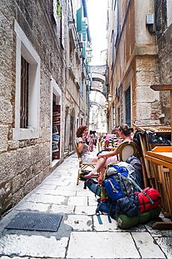Backpackers outside a bar, Split, region of Dalmatia, Croatia, Europe