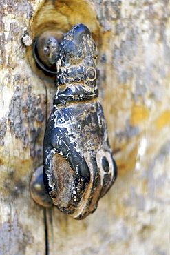 A 'hand of Fatima' door knocker on a door in the kasbah of Ait Ben Haddou near Ouarzazate in Morocco